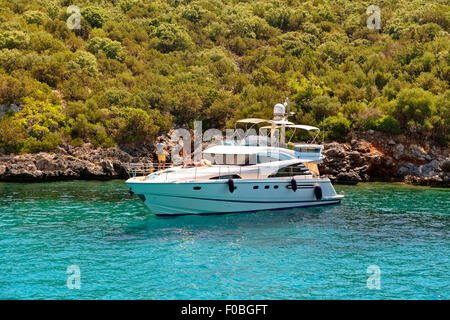Small motor cruiser anchored in the Mediterranean. - Stock Photo