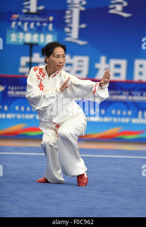 Ordos, China's Inner Mongolia Autonomous Region. 12th Aug, 2015. An athlete from north China's Hebei Province competes - Stock Photo