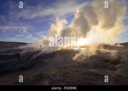 Geysers of the thermal field Sol de Mañana during sunrise, Potosi, Bolivia - Stock Photo