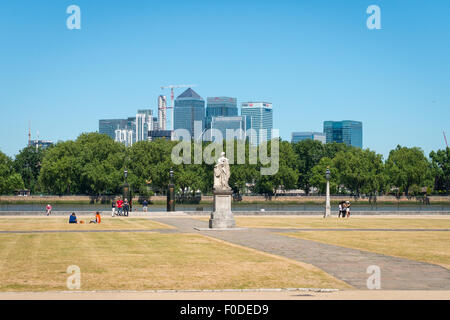 London Southbank Greenwich University lawns statue sculpture Water Gate River Thames Canary Wharf blue sky summer - Stock Photo