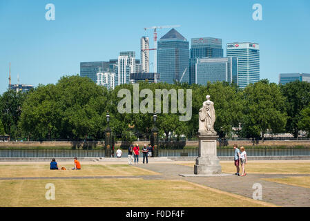 London Southbank Greenwich University grounds view of Water Gate towards Canary Wharf over River Thames people grass - Stock Photo