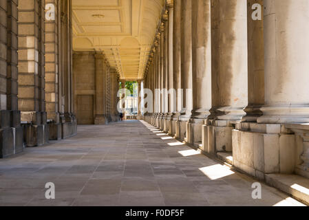 London Southbank Greenwich Maritime Royal Naval College neo classical Chapel detail colonnade pillars pillar column - Stock Photo