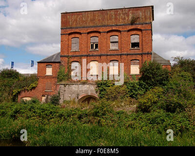 Old derelict commercial building beside the Bridgwater and Taunton Canal, Taunton, Somerset, UK - Stock Photo