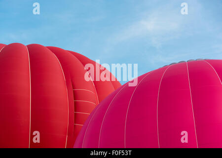 Brightly coloured balloons inflating at the 37th Annual Bristol Balloon Fiesta, - Stock Photo