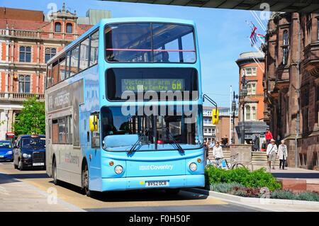 Modern blue bus passing the Council House, Coventry, West Midlands, England, UK, Western Europe. - Stock Photo