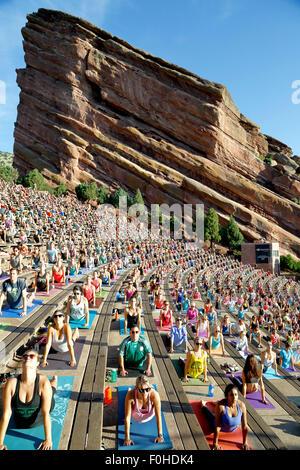 Yoga practitioners, Yoga on The Rocks, Red Rocks Amphitheatre, Morrison, Colorado USA - Stock Photo