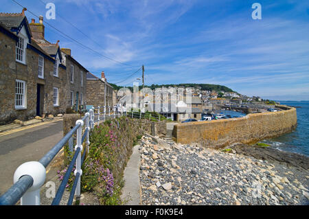 Horizontal street view of Mousehole in Cornwall. - Stock Photo