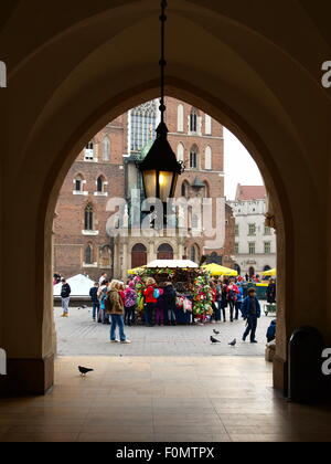 Krakow, Main Market Square, antique Cloth Hall Sukiennice. View of St. Mary's Basilica. - Stock Photo