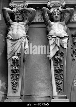 Neo-classical statues above  entrance to the glass-covered arcade in Bucharest, Romania - Stock Photo