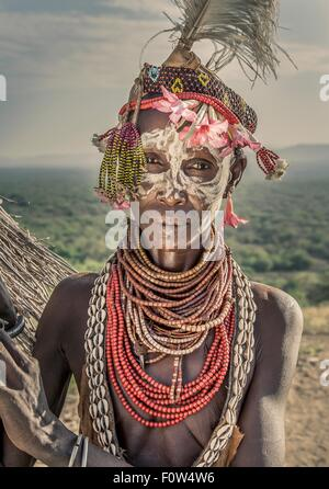 Portrait of mature woman from Karo tribe wearing traditional costume, Ethiopia, Africa - Stock Photo