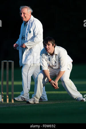 Poole CC bowler in action. - Stock Photo