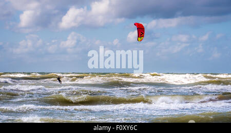 Wakeboarder making tricks on waves at baltic sea - Stock Photo