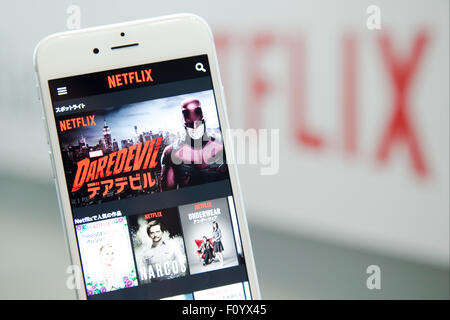 Netflix service for Japanese mobile phones on display during a media event to announce a business alliance for the - Stock Photo