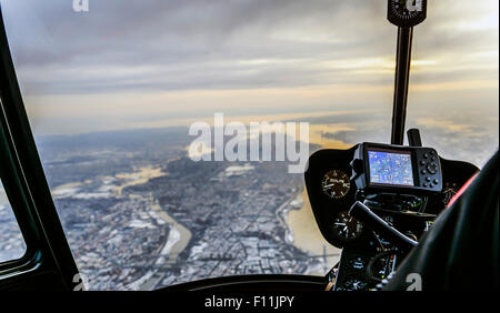 Close up of controls in airplane flying over New York, New York, United States - Stock Photo