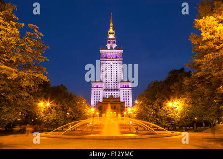 The Palace of Culture and Science in Warsaw, Poland at night. - Stock Photo