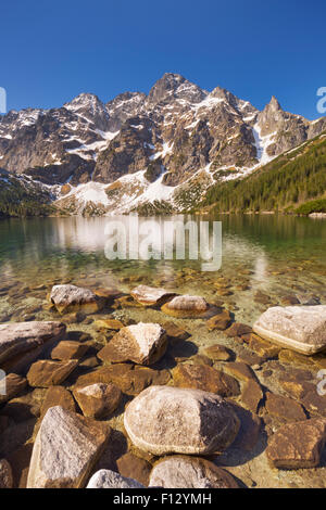 The Morskie Oko mountain lake in the Tatra Mountains in Poland, on a beautiful bright morning. - Stock Photo