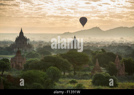 Hot air balloon over the Temples of Bagan at dawn, Myanmar, November 2012. - Stock Photo