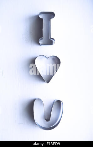 I love you message made from metal pastry cutters - Stock Photo