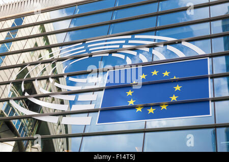 Logo of the European Parliament at the facade of European Parliament building in Leopold Square. August 21, 2015 - Stock Photo