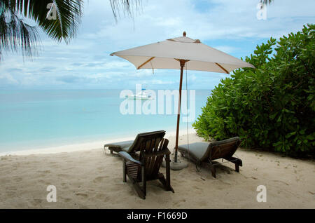 Oct. 15, 2014 - Seychelles - chairs are under the trees on the sandy shores of the Indian Ocean, Denis island, Seychelles - Stock Photo