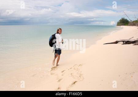 Oct. 15, 2014 - Seychelles - man walking along the sandy shores of the Indian Ocean, Denis island, Seychelles (Credit - Stock Photo
