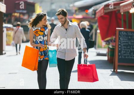 Couple shopping in Paris - Stock Photo