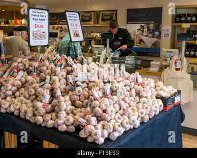 A display of new season French Tarn Rose Garlic on sale in a specialsi grocer's shop in North Yorkshire England - Stock Photo