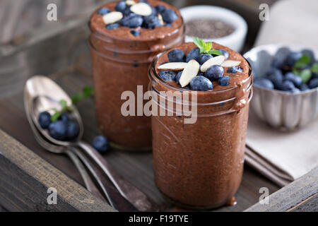 Healthy vegan chocolate chia pudding in jars - Stock Photo