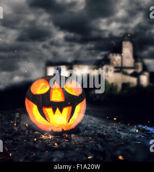 Halloween pumpkin in a forest at night - Stock Photo