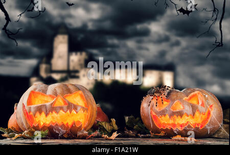 Halloween pumpkins in a forest at night - Stock Photo