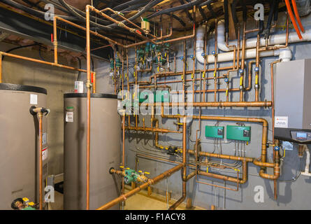 Copper Water Pipes In Basement Of New Large Home - Stock Photo