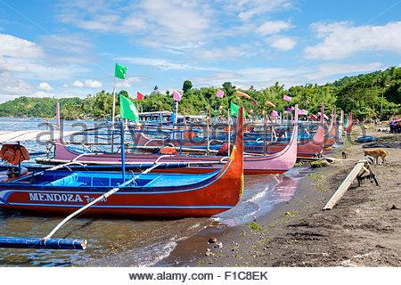 Traditional Bangka boats docked on on the shore of Taal Lake on Taal Volcano Island, Talisay, Batangas Province, - Stock Photo