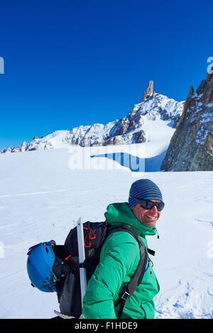 Portrait of mature male skier on Mont Blanc massif, Graian Alps, France - Stock Photo