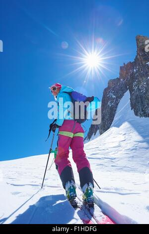 Mature female skier moving up Mont Blanc massif, Graian Alps, France - Stock Photo