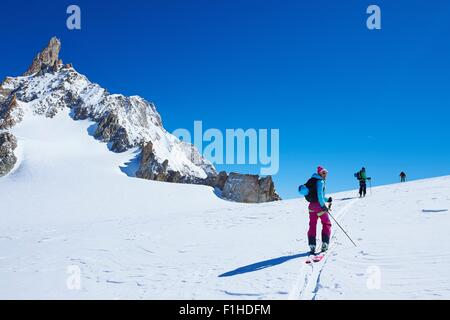 Three mature adult skiers moving up Mont Blanc massif, Graian Alps, France - Stock Photo