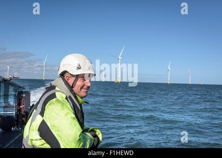 Crew member on deck of boat on offshore wind farm - Stock Photo