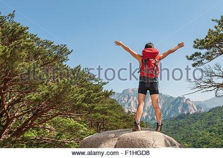Hiker enjoying the view on the way to Mt. Ulsanbawi at Seoraksan national park, Gangwon, South Korea - Stock Photo