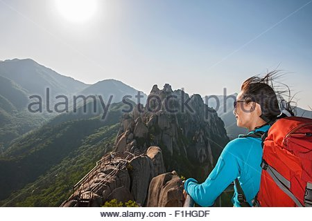 Hiker on top of Mt. Ulsanbawi at Seoraksan national park, Gangwon, South Korea - Stock Photo