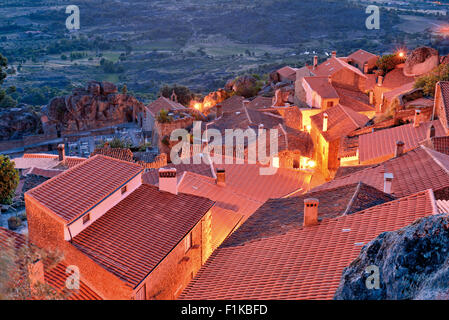 Portugal: Overlooking the rooftops of historic  mountain village Monsanto by night - Stock Photo