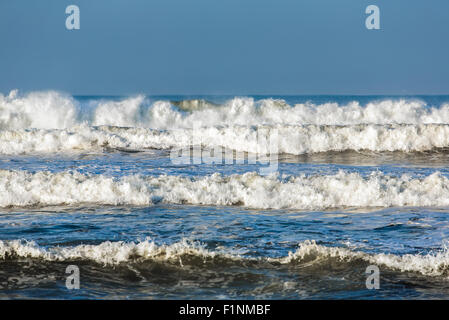 Storm waves breaking during windy day on Java, Indonesia. - Stock Photo