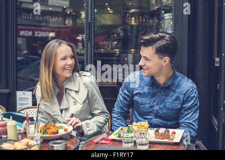 Paris, Couple dating at the restaurant - Stock Photo