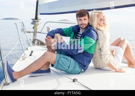 Young couple relaxing on sailboat, Adriatic Sea - Stock Photo