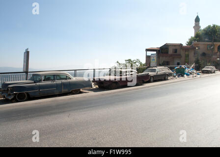 Out of service American cars old fashion shape left back on the side road  Lebanon - Stock Photo