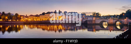 Portugal, the Algarve, Tavira, panoramic view over the river Gilao in the evening towards the town and mediaeval - Stock Photo