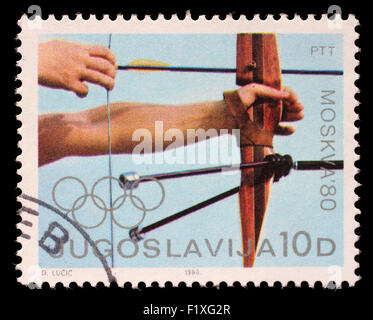 Stamp printed in Yugoslavia shows Archery competition, Olympic games in Moscow, circa 1980 - Stock Photo