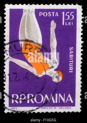 Stamp printed in the Romania shows Woman Diver, Jumping into Water from Platform, circa 1963 - Stock Photo