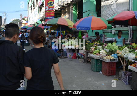 The market place inTugeogharo the northern most state of thePhilippines.Streets stalls selling everything from fresh - Stock Photo