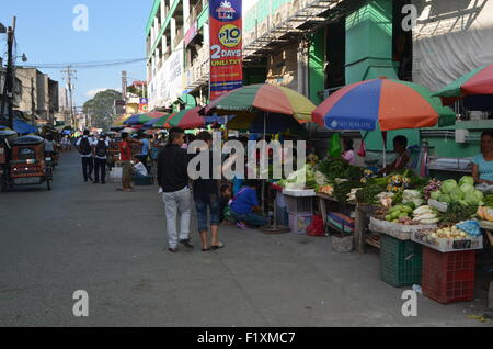 The market place inTugeogharo the northern most state of thePhilippines Streets stalls sellingfresh vegetables to - Stock Photo