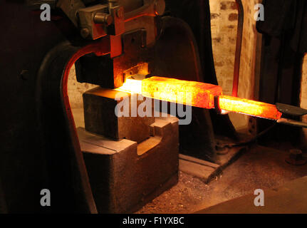 The Working of Red Hot Metal in a Large Foundry Forge. - Stock Photo