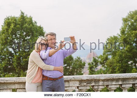 Senior couple taking self portrait, using smartphone - Stock Photo
